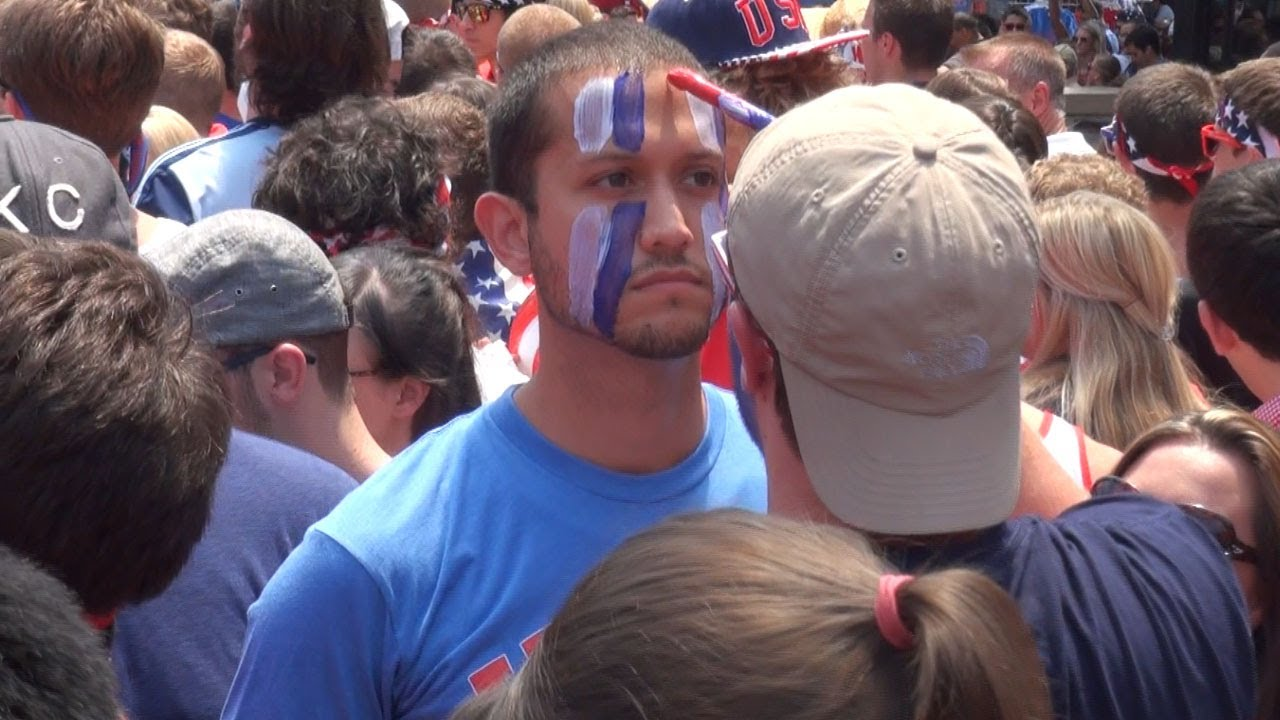 America- kansas city man gets his face painted inside the crowed World Cup 2014 USA vs Belgium